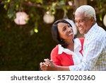senior black couple dancing in... | Shutterstock . vector #557020360