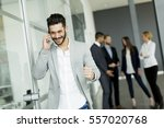 businessman using mobile phone... | Shutterstock . vector #557020768