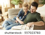 couple planning out furniture... | Shutterstock . vector #557023783