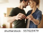 young couple holding up new... | Shutterstock . vector #557025979