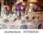 round dinner table decorated...   Shutterstock . vector #557030524