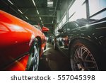 many cars parked in garage | Shutterstock . vector #557045398
