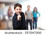 little boy singing | Shutterstock . vector #557047300
