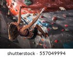 young woman training on... | Shutterstock . vector #557049994