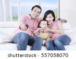 cute daughter and her parents... | Shutterstock . vector #557058070