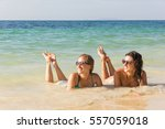 two girl friends smiling while... | Shutterstock . vector #557059018