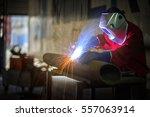 welder working and carrying... | Shutterstock . vector #557063914