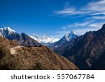 Small photo of Sunny panoramic view into Khumbu Valley with Snowy 8000er Mountains (from left: Tobuche, Nuptse, Everes, Lhotse, Ama Dablan) with blue sky