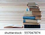open book  stack of hardback... | Shutterstock . vector #557067874
