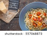 pasta with tomato  parmesan... | Shutterstock . vector #557068873