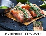 slices of raw salmon smeared... | Shutterstock . vector #557069059