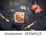 pieces of raw salmon on ice and ... | Shutterstock . vector #557069119