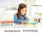 little girl writing something... | Shutterstock . vector #557070520