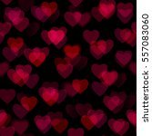 red blurred hearts isolated on...   Shutterstock . vector #557083060