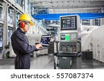 engineer using laptop computer... | Shutterstock . vector #557087374
