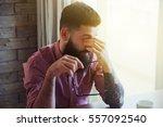 stressed bearded man in glasses ... | Shutterstock . vector #557092540