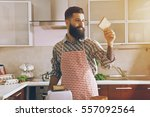 bearded man making toasts with... | Shutterstock . vector #557092564