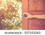 Women Hand Open Door Knob Or...