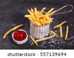 french fries with ketchup on... | Shutterstock . vector #557139694