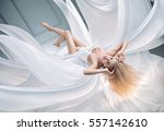 sexy blonde beauty flying over... | Shutterstock . vector #557142610