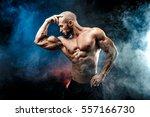 strong bald bodybuilder with... | Shutterstock . vector #557166730
