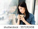 young beautiful asian woman... | Shutterstock . vector #557192458
