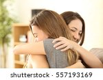 happy girls embracing at home... | Shutterstock . vector #557193169