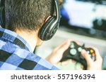 video gamer playing a videogame ... | Shutterstock . vector #557196394