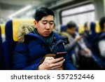 Asian Man Using Smartphone On...