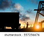 silhouette engineers waving to... | Shutterstock . vector #557256676