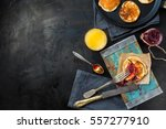 pancakes with  jam on a blue... | Shutterstock . vector #557277910