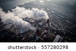 Small photo of Air pollution by smoke coming out of two factory chimneys. Industrial zone in the city. Kiev, Ukraine, aerial view
