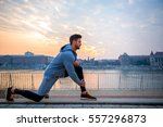 a handsome young man stretching ... | Shutterstock . vector #557296873