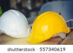 safety helmets white and yellow ... | Shutterstock . vector #557340619
