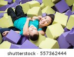 asian mother and her son... | Shutterstock . vector #557362444