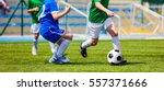 children soccer players running ... | Shutterstock . vector #557371666