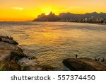 sunset on ipanema beach and... | Shutterstock . vector #557374450