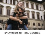 young lovers visiting florence... | Shutterstock . vector #557380888