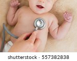 baby at the doctor getting... | Shutterstock . vector #557382838