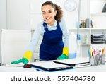 pretty woman in uniform with... | Shutterstock . vector #557404780