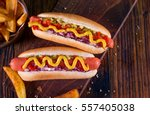 Stock photo  hot dog with yellow mustard onion pickles and french fries 557405038