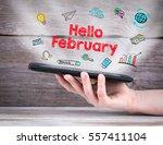hello february. tablet computer ... | Shutterstock . vector #557411104
