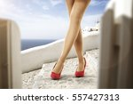 woman legs and heels  | Shutterstock . vector #557427313