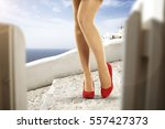 woman legs and heels  | Shutterstock . vector #557427373