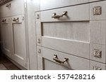 Stock photo retro handles metal cabinet in the kitchen 557428216
