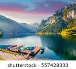 misty summer morning on the... | Shutterstock . vector #557428333