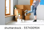 happy young couple moving in... | Shutterstock . vector #557430904