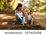 mother and daughter relaxing in ... | Shutterstock . vector #557432458
