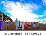 Surf Boards Standing Along The...