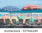 Striped Umbrellas On The Beach...
